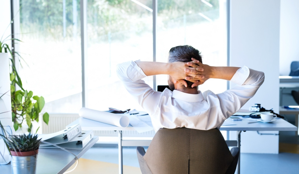 Businessman-at-the-desk-in-his-office-resting.ee44-min